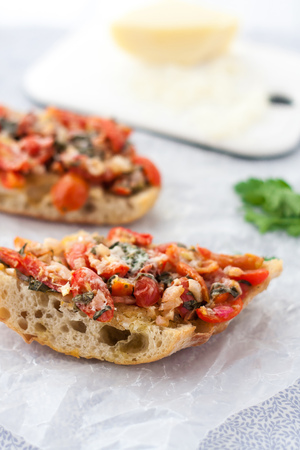 open topped: two slices of fresh homemade bruschetta with  on a white paper