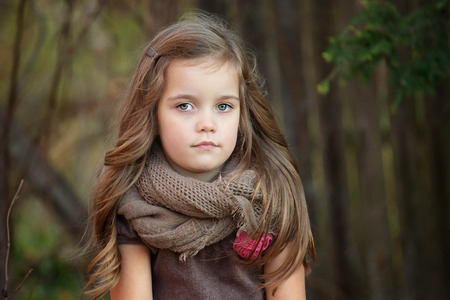 and four of the year: portrait of a beautiful four year old girl with long hair on a warm autumn day, horizontal image