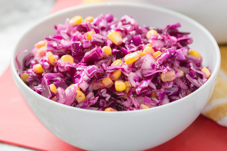 red cabbage shredded in white bowl with a simple salad dressing