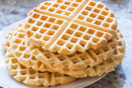 a stack of plain round waffles without toppings