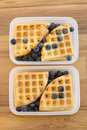 school lunch for kids: plain waffles and berries in a plastic container, two portions