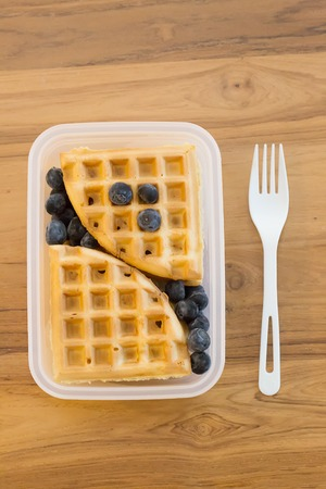 school lunch for kids: plain waffles and berries in a plastic container, portion for one