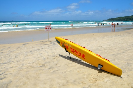 byron: Yellow surf rescue board on an Australian sandy beach