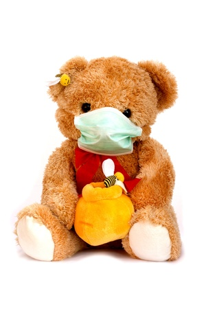 Bear on a white background in protective mask photo