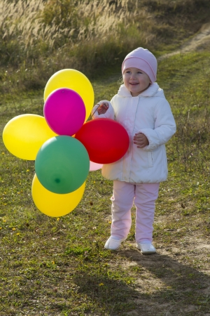 a little girl with balloons photo