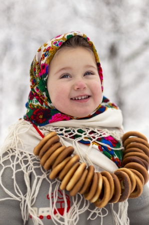 little girl with bagels in winter photo