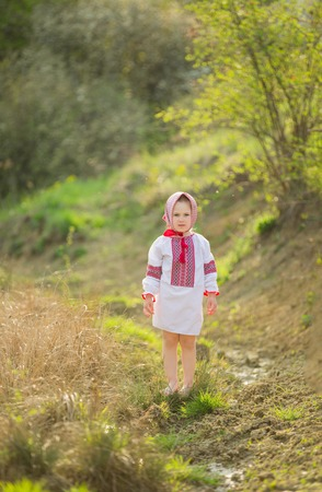 national costume: Girl in national costume in nature Stock Photo