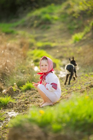 national costume: Girl in national costume with the kid Stock Photo