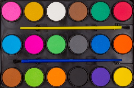 nuance: box of paints close-up as background