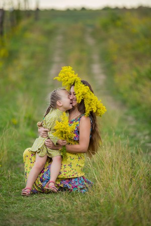 flowering field: mother with her child on a flowering field