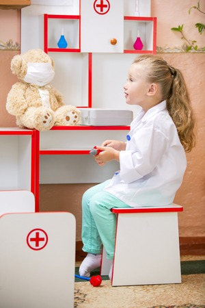 medical cabinet: Portrait of a child on a background of medical doctors cabinet Stock Photo