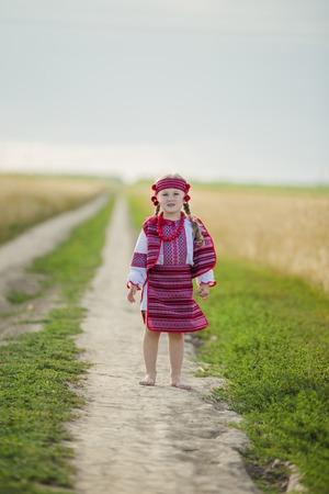 national costume: girl in the Ukrainian national costume near wheat Stock Photo