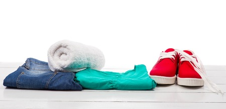 galoshes: Red shoes and clothes on a white table