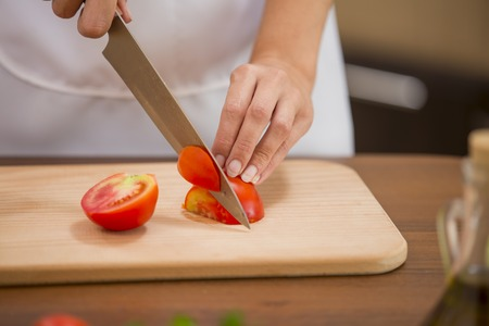 cutting: Cutting tomato close up as background