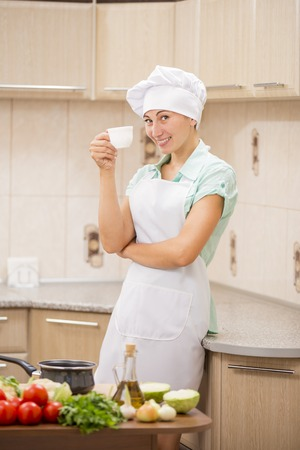 culinary skills: Girl on the background of the kitchen chef