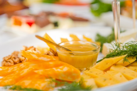 cheese platter: cheese platter with honey and walnuts