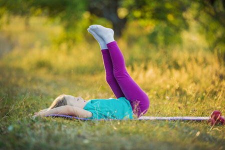 outdoor exercise: little girl goes in for sports on nature