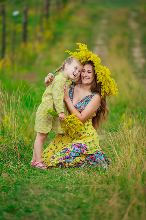 flowering field: mother with her baby on a flowering field
