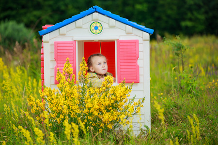 playhouse: girl in a playhouse in nature