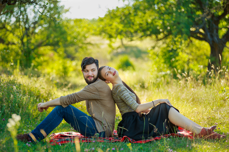 Happy couple sitting in nature Stock fotó