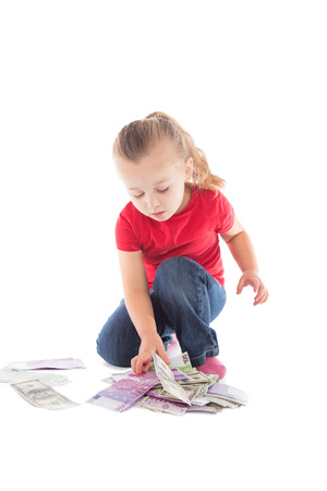 little girl with a bunch of money on a white background