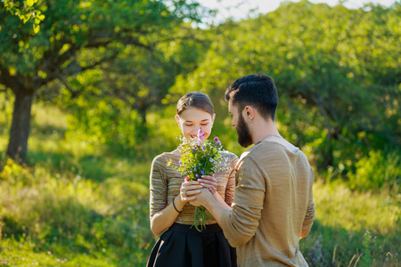 Happy couple with flowers on nature Stock fotó