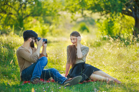 beautiful couple with camera on nature