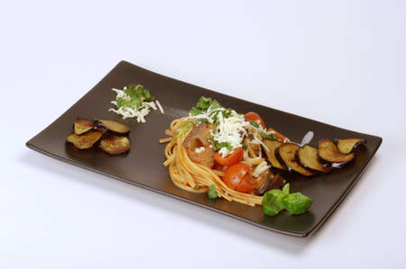 plate of linguine on the norma on white background photo