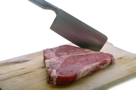 florentine: Florentine steak on wooden chopping board with cleaver Stock Photo