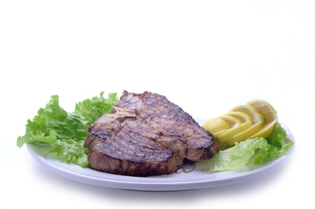 florentine steak on platter over white background photo