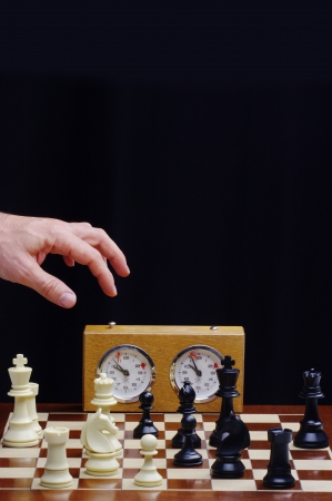 game of chess with clock photo