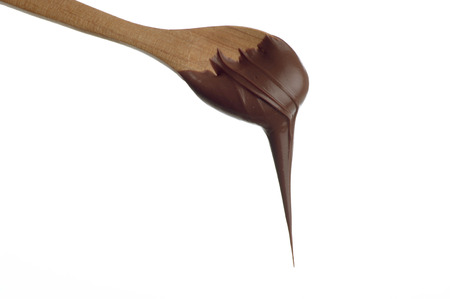 wooden spoon: spoon with chocolate cream Stock Photo