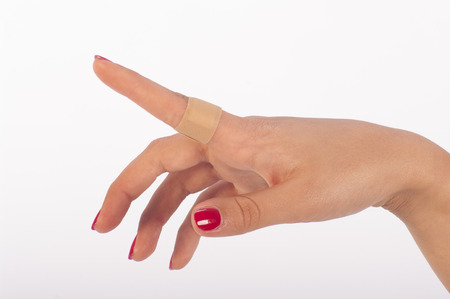 scarring: woman s hand with plaster on white background Stock Photo
