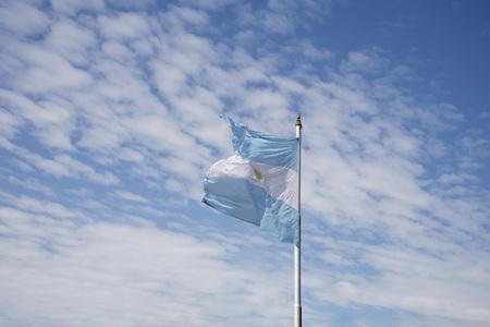 sways: Argentine flag on blue sky
