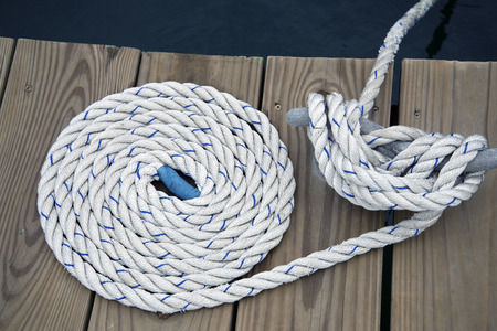 White rope with mooring bollard