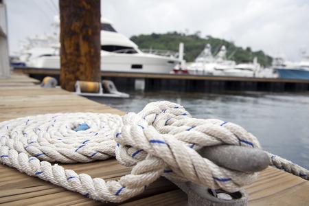 mooring bollard: White rope with mooring bollard