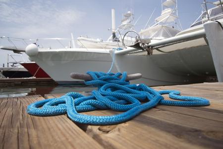 mooring bollard: Blue rope with mooring bollard