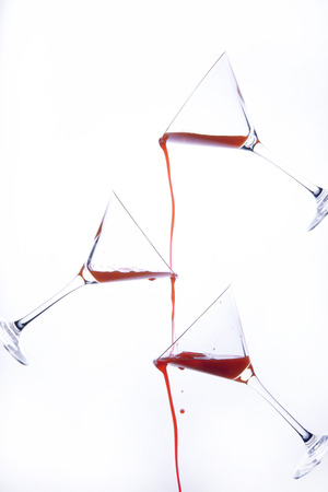 bacchus: red liquid poured on cocktail glass Stock Photo