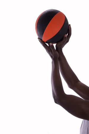 basketball with hands of man on a white background