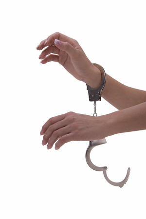 denunciation: womans hand with handcuffs on white background Stock Photo