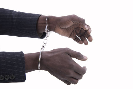 criminal: hands of man in handcuffs on a white background Stock Photo