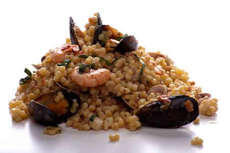 Sardinian fregola with seafood on a white background Stockfoto
