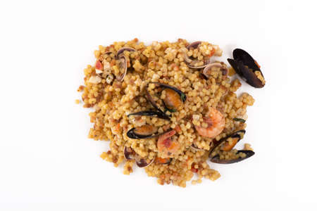 Sardinian fregola with seafood on a white background