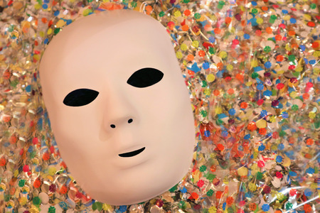 carnival mask on colored tinsel background Imagens