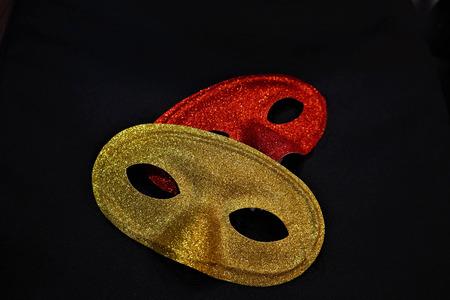 golden and red carnival masks on a black background