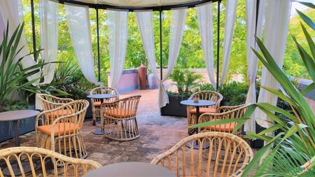 interior design, wicker chairs on the terrace, garden