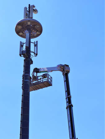 Telecommunication tower of 4G and 5G cellular. Cell Site Base Station. Wireless Communication Antenna Transmitter. Telecommunication tower with antennas against blue sky background. Technology on the top of the telecommunication GSM (5G, 4G)