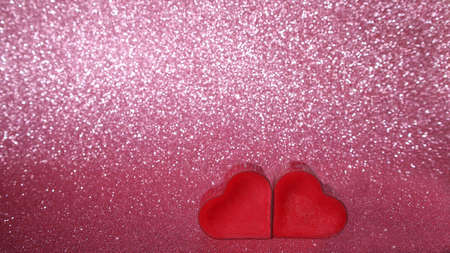two red hearts on a pink background. copy space. banner Valentine's day greeting card. love concept.