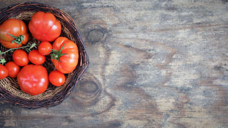 tomato on a wooden background. view from above. Copy space banner. flat lay