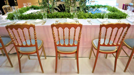 Wedding decoration. Wedding celebration. Banquet table designed in Art Nouveau style for a wedding party Flower decorations for holidays and wedding dinner. Banquet table designed in Art Nouveau style for a wedding party 版權商用圖片